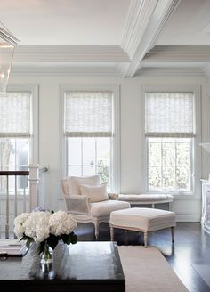 Millwork needs to come back. It is gorgeous. Love the dark floors and stark white everything else. Hydrangeas are my favorite ; )