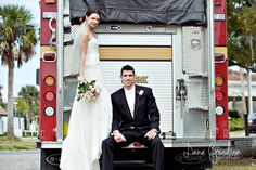 Firefighter wedding. Instead of him sitting, both standing and kissing