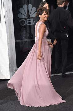 Pin for Later: Relive the Best Moments From the 2014 Emmys  Presenter Halle Berry smiled in her flowing gown.