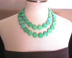 """The stones are approximately 20mm round. The first strand falls 18""""L, and the second strand falls at 22""""L. I have used a sterling silver large hook & eye clasp.    Chrysoprase stone is generally a beautiful apple-green, but can vary to deep green in color. This stone is such a happy color!"""