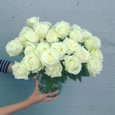 Love the elegance of white roses!