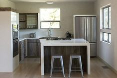 Michael Roche Napa Valley kitchen | Remodelista I don't usually pin extreme modern, but I love this, including the Ikea cabinets.