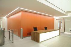 Light + Design - 50 George Street. Reception Opal Line of Light Backlit Desk