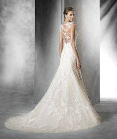 Pladie by Pronovias Beige tulle mermaid-style wedding dress. Bodice with sheer…