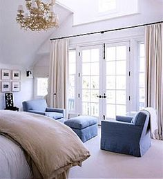 Master bedroom. Nice french doors. And color scheme. And chandelier. And skylight!!! And sitting area! I love it ALL :)