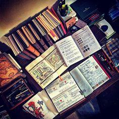 An overhead photo of serious invention in progress. #travelersnotebook #traveljournal #leathernotebook #leatherjournal #journal #notebook #stationery #planner #artjournal #bulletjournal #startbaynotebooks