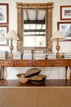 Stacked books, baskets, long rustic console