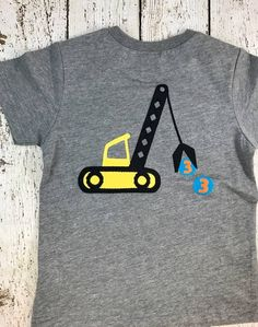 Pictured using bright, fun colors for a dirt digging, truck loving dude! Can be created with any birthday number inside the little details being picked up by crane. Hand-made, crane applique with little birthday number details being hauled away. Perfect design for a construction themed party. Please let me know if you prefer the lettering in different colors. I will gladly customize. OUR DESIGNS ARE MADE TO ORDER AND CUSTOMIZABLE. THEY CAN BE CREATED FOR ANY CELEBRATION 0 -100+. WE ALSO C...