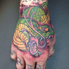 James Tex - Deadly Tattoos Inc. Calgary, Canada.  Hand Tattoo. Snake.