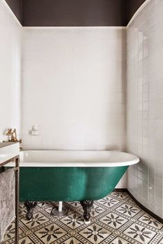 Moroccan Tile is where it's at, and that green claw foot tub. wow.
