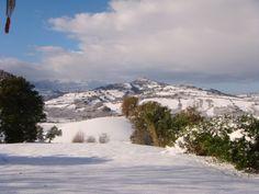 One beautiful snowy morning looking across from Curetta, Servigliano towards Penna San Giovanni. View from villa-miramonti.com