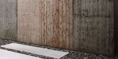 Hagi Store and Studio - Sambuichi Architects  The timber formwork for the concrete is reused as shutters...