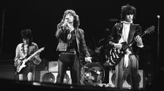 (left to right) Bass player Ronnie Wood, singer Mick Jagger, and guitarist Keith Richards of British rock group the Rolling Stones perform on stage in June 1976. (Photo by Express/Getty Images)