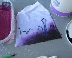 Dress up a basic tee by drawing on your city skyline, and adding an ombre wash. Free and easy tutorial from Pixie Faire, using the Liberty Jane Baseball tee pattern!