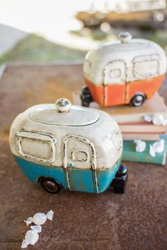 "These quirky canisters will brighten up your home whether they're holding candy in the kitchen or toiletries in the bathroom. Product Description • Large Dimensions: 5"" x 10"" x 8.5"" T • Small Dimensio"