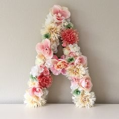 """19"""" floral letter that can be hung on the wall. These letters are perfect for bridal showers, wedding decor, baby showers, nursery decor, personalized gifts, birthday parties, photo shoot props, sorority events, and more."""