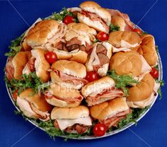 small sandwiches (turkey & ham) with mayo & lettuce.