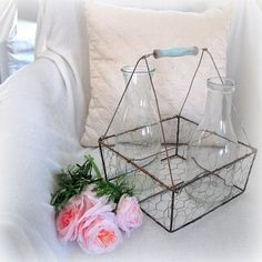 vintage wire milk basket made from a dollar store basket, chicken wire, and a wire hanger Vintage Wire Baskets, Metal Baskets, Hanging Baskets, Dollar Store Crafts, Dollar Stores, Chicken Wire Crafts, Wire Hangers, Wire Art, A Table