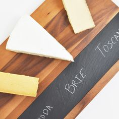 The holidays are just around the corner! That means entertaining and spending time with family and friends. Our newest arrival - an acacia cheese serving board with slate inlay - is the best way to entertain in style! Lay your spread out on the board and write the names of the different cheeses and foods so your guests never have any questions again. #cheeseboard #holidayparty #holidaystyle #servingboard #holidaygift #hostessgift