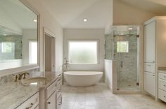 Traditional Master Bathroom with Complex Marble, frameless showerdoor, High ceiling, Inset cabinets, Flat panel cabinets