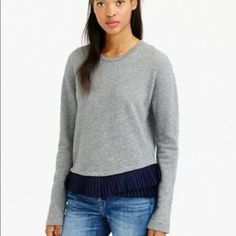 Beautiful Jcrew peplum sweater! Beautiful Jcrew xxs pleaded peplum sweater. Sweater is gray pleaded peplum is navy blue. So pretty with jeans and boots :) J. Crew Sweaters Crew & Scoop Necks