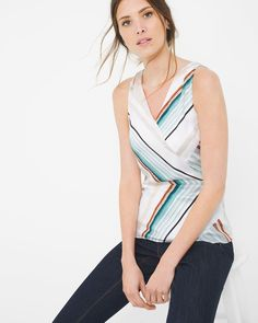 """We've deemed this tank a summer necessity, thanks to its energized stripes and silky hand. Its tailoring is equally impressive. Think pieced panels that create a surplice effect and a breezy keyhole back. Since this design comes equipped with color, nude sandals are your best bet for footwear.   Angled stripe tank   Fully lined    Polyester. Machine wash, cold.   Approx. 26"""" from shoulder   Imported"""