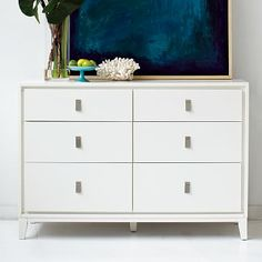 Niche 6-Drawer Dresser - White $749 -- I'd change out the nobs for something brass/gold