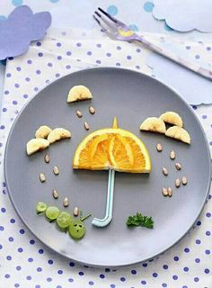 Cleverly cute!! #orange #grapes #banana #corinderleaves #seeds #rain #umbrella #caterpiller #clouds ☔☁
