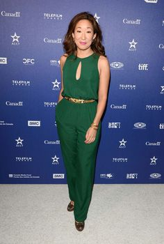 What a great jumpsuit.  I adore the green color, and that little cutout at the neck.  I also like the gold belt. | Sandra Oh
