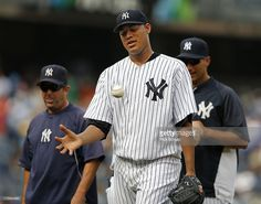 Pitcher Ivan Nova #47 walks off the field after throwing a complete game, three hit shutout against the Baltimore Orioles in a MLB baseball game at Yankee Stadium on August 31, 2013 in the Bronx borough of New York City. The Yankees defeated the Orioles 2-0.