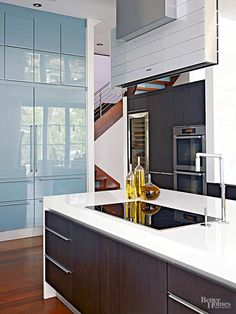 Get inspired by these kitchen layout and design ideas. These modern twists on classic kitchen design elements are creative for those looking to do a contemporary kitchen remodel. You'll love that these innovative kitchen updates are anything but traditional.
