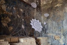 Polish artist NeSpoon combines lace-making, ceramics and street art.