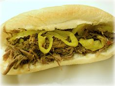 Slow Cooker Italian Beef Sandwiches. Only 4 ingredients! So easy to make.