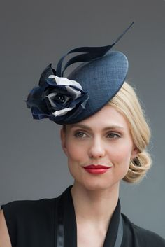 Handmade in our London studio. Pinopok cocktail hat with handmade silk flowers. Colours: Navy Blue base. Ivory, Navy Blue and Royal Blue flowers....