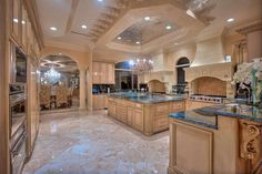Great Kitchen Design and Ideas with Cabinets, Islands, Backsplashes – Photo Gallery – Luxury kitchen designs with very high ceiling with special beige decorations and spot lights. The kitchen has many ovens and a large wooden island in the middle of it. Luxury Kitchen Design, Dream Home Design, Luxury Kitchens, My Dream Home, Cool Kitchens, Dream Kitchens, Tuscan Kitchens, Beautiful Kitchens, Beautiful Homes