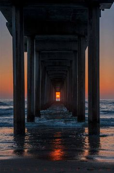 Twice a year, the sun lines up perfectly between the pillars of Scripps Pier in La Jolla, California.