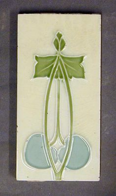 "Minton, Hollins and Co tube-lined dust-pressed tile, vertical Art Nouveau stylised floral design, polychrome glazed, 6"" x 3"", c1910."