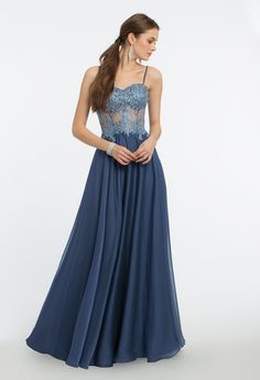 Step into a dream-like atmosphere in this ethereal evening gown! The spaghetti straps, molded cups illusion bodice, and ballgown chiffon skirt give this prom dress a lovely finish. Pair it with rhinestone heels, a rhinestone ring, and a gold clutch to complete. #camillelavie