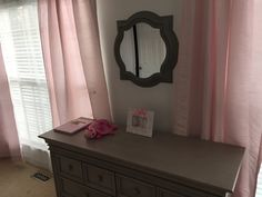 This nursery mirror gives such a pop to my daughter's nursery. The silver color matches her crib and dresser perfect.  Nursery mirror purchased from Marshalls for $24.99.
