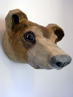 Paper mache bear, looks like it was carved out of wood.