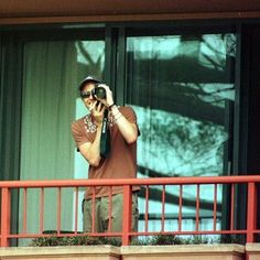Heath playfully taking photos of the paparazzi, returning their intrusion with his characteristic charm.