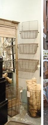 wire baskets mounted on wall inside garden shed to hold tools, etc.