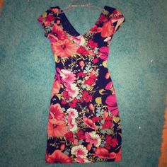 Floral Bodycon Dress Floral bodycon dress with cross back. Super flattering and comfortable. Can't model because it doesn't fit me anymore, sorry!! Only worn once to a party. Wet Seal Dresses Mini