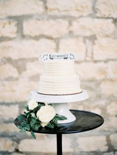 Sweet and simple wedding cake: http://www.stylemepretty.com/2015/02/10/neutral-colored-texas-hill-country-wedding/ | Photography: Loft - http://loftphotographie.com/