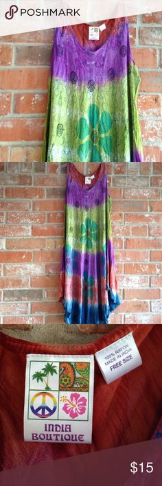 """Flower Power Dress/cover Up This dress is sooo cute. In EUC. It is tie dyed so there will be different spots around on material. I wore this once on vacation. It says free size but i would say up to 3X is best. it measures 26"""" underarm to underarm at largest stretch and is 42"""" long at longest. Dresses Asymmetrical"""