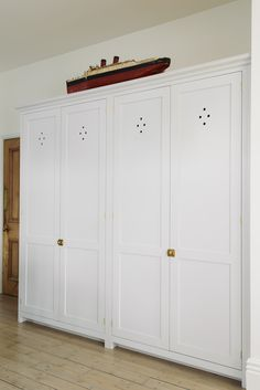 Two beautiful deVOL pantry cupboards with pretty petal cutouts, the perfect place to store all of your kitchen clutter. - All About Gardens Bedroom Cupboard Designs, Bedroom Cupboards, Larder Cupboard, Cupboard Doors, Pantry Doors, Gothic Home, Shaker Kitchen, White Kitchen Cabinets, Laundry Rooms