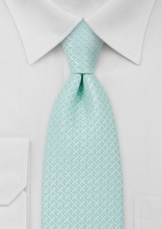 hen worn on a sunny day the turquoise and light silver color combination of this tie gives off a brilliant shine.
