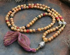 Mala made of 108, 10 mm - 0,394 inch, beautiful faceted agate gemstones and decorated with hematite and three handmade Nepalese beads - look4treasures on Etsy