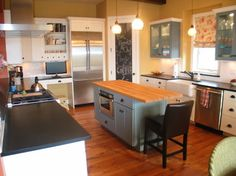 islander color.  Chalkboard paint on pantry door?  Medallion Cabinetry in New Construction - traditional - kitchen - denver - High Country Kitchens