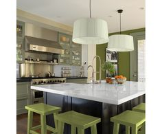 Sign me up for this kitchen! No clutter, modern, but not boring, and green! I love the color green!